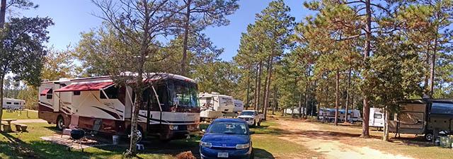 Rustic RV parking at Wilderness RV Park in Robertsdale AL