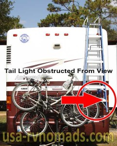 This RV step ladder obstructs the right tail light.