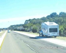 RV tire failure can be caused by excessive speed, age of the tires, and road hazards.