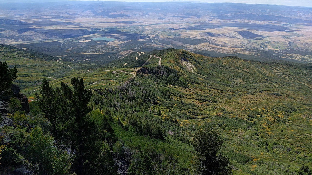 You can see all the way to Grand Junction and beyond from Land's End at Grand Mesa National Forest.