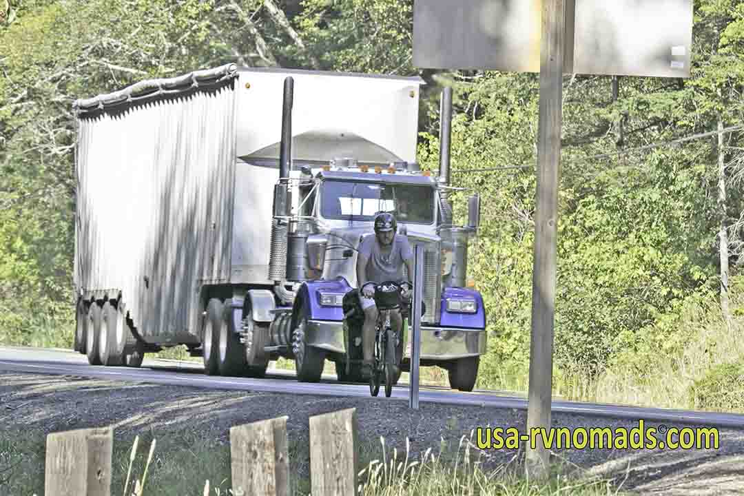 Big semi passing a bicyclist on Pacific Coast Highway 101.