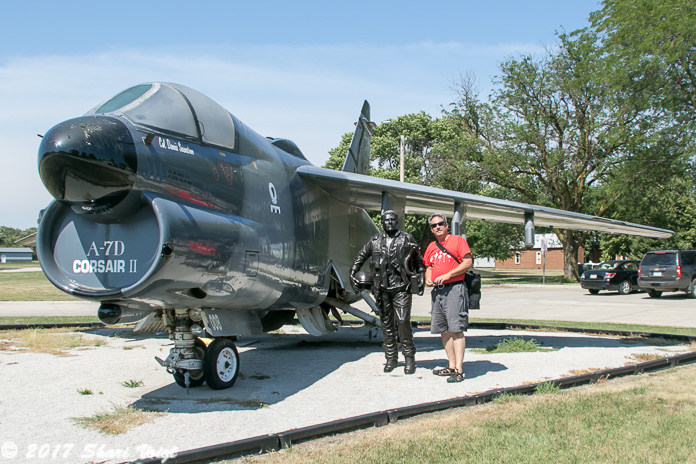 An A-7D Corsair II in front of The Monona County Veteran's Memorial Museum.