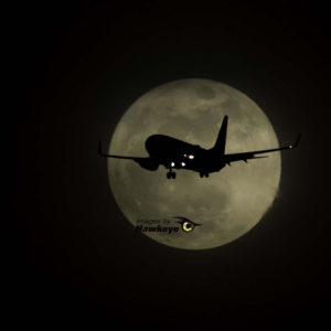 Nighttime photography and plane spotting combined with a full moon.