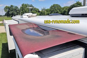 Pooling water on your old slide topper can cause RV slide leaking.